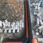 Sint-Pieters-Leeuw openbreken garagevloer en klinkerpad herstellen aanleg RWA buizen toezichtputje gescheiden riolering 1 - Massaert bvba