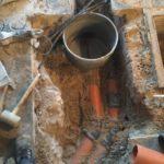 Sint-Pieters-Leeuw openbreken garagevloer en klinkerpad herstellen aanleg RWA buizen toezichtputje gescheiden riolering 3 - Massaert bvba