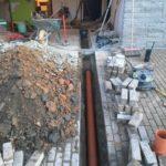 Sint-Pieters-Leeuw openbreken garagevloer en klinkerpad herstellen aanleg RWA buizen toezichtputje gescheiden riolering 4 - Massaert bvba