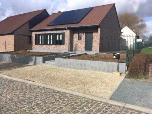 aanleg buitentrap pad voordeur kassei terras oprit grind stabilisatiematten Vlezenbeek
