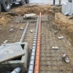 aanleg gescheiden rioleringsstelsel Vlezenbeek met infiltratieput hemelwaterput septische put_0770 - Massaert bvba