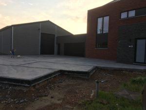 aanleg oprit in gepolierd beton