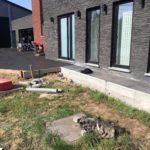 aanleg oprit in gepolierd beton met parkeerplaatsen omlijst door replica klinkers _4 - Massaert bvba