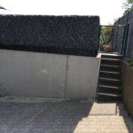 plaatsen Schanskorven bovenop prefab keerwand Sint-Pieters-Leeuw 3 - Massaert bvba