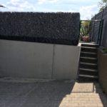 plaatsen Schanskorven bovenop prefab keerwand Sint-Pieters-Leeuw 4 - Massaert bvba